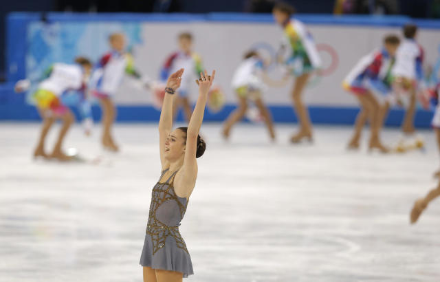 Adelina Sotnikova of Russia acknowledges the crowd after completing her routine in the women's free skate figure skating finals at the Iceberg Skating Palace during the 2014 Winter Olympics, Thursday, Feb. 20, 2014, in Sochi, Russia. (AP Photo/Vadim Ghirda)