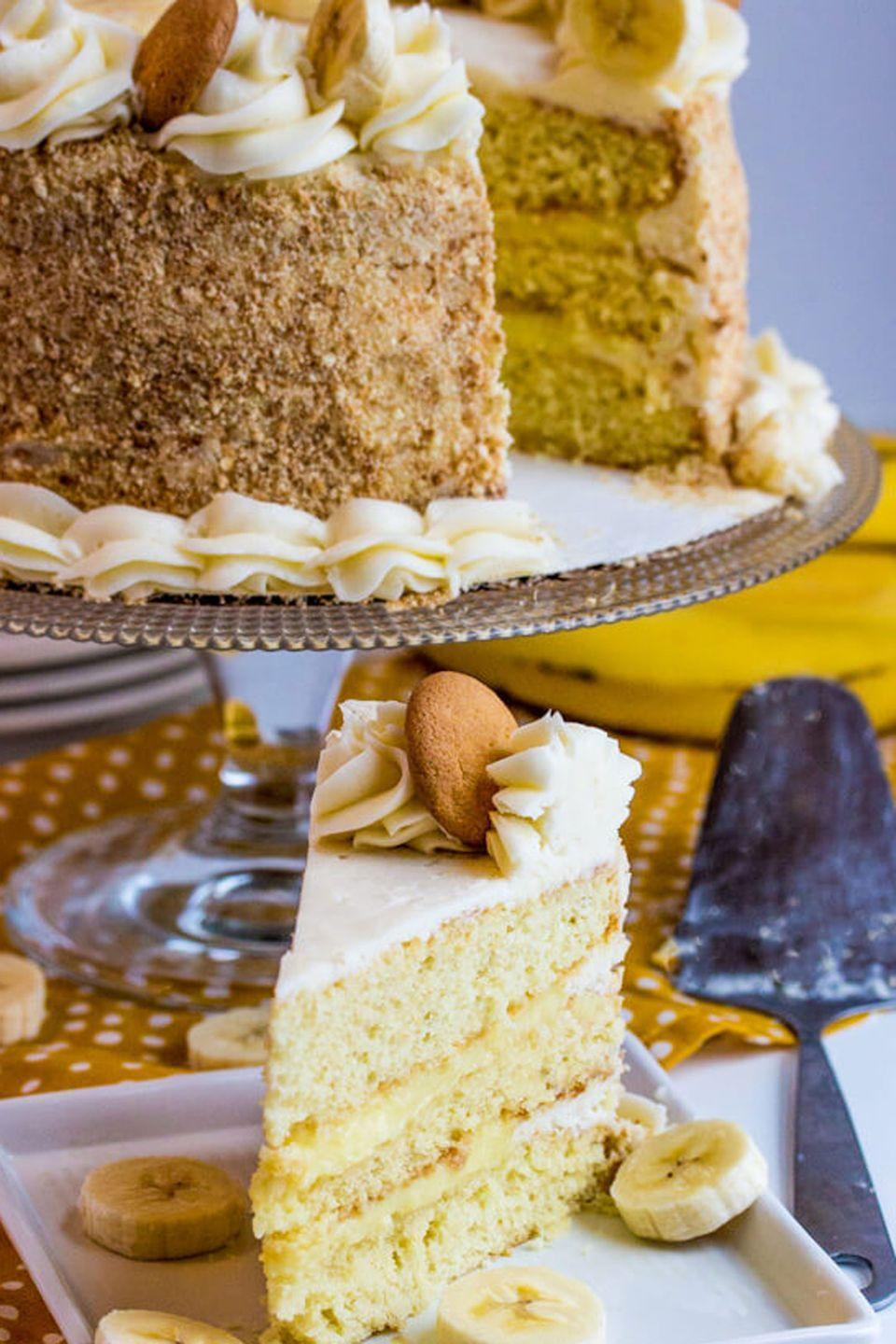 """<p>Trade whipped cream for regular ol' vanilla frosting in this fresh take on a classic.</p><p><em><a href=""""https://tornadoughalli.com/2017/03/banana-cream-cake/"""" rel=""""nofollow noopener"""" target=""""_blank"""" data-ylk=""""slk:Get the recipe from Tornadough Allie »"""" class=""""link rapid-noclick-resp"""">Get the recipe from Tornadough Allie »</a></em> </p>"""