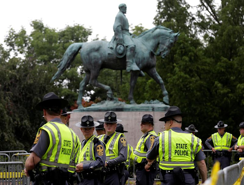 Virginia State Troopers stand under a statue of Robert E. Lee. White nationalists descended on Charlottesville to protest the statue's removal.