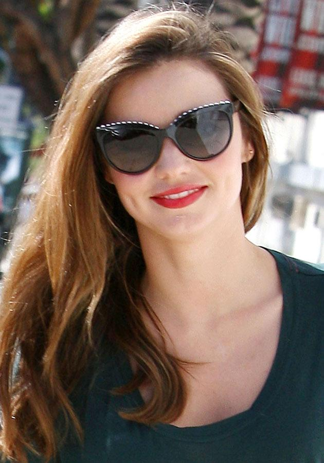 Celebrities wearing red lipstick: Miranda Kerr finished off her off-duty look with a slick of red lipstick.<br><br>[Rex]