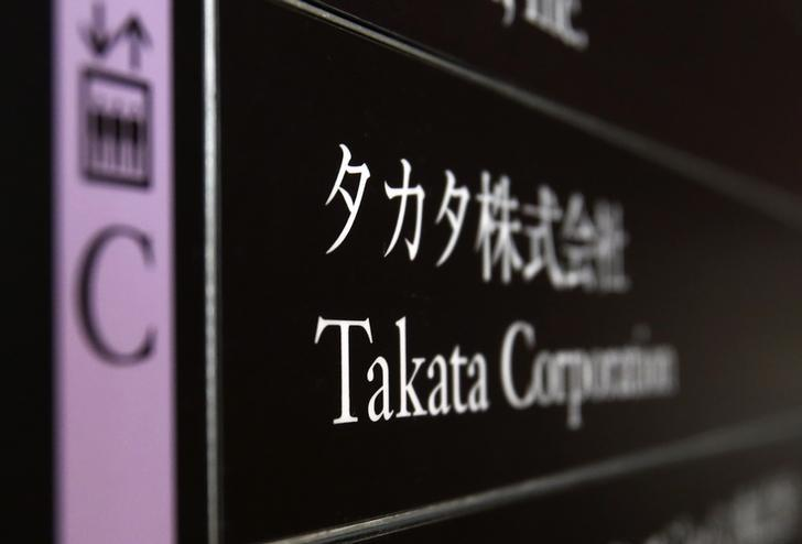 Takata Corp's company plate is seen at an entrance of the building where Takata Corp headquarters is located at in Tokyo