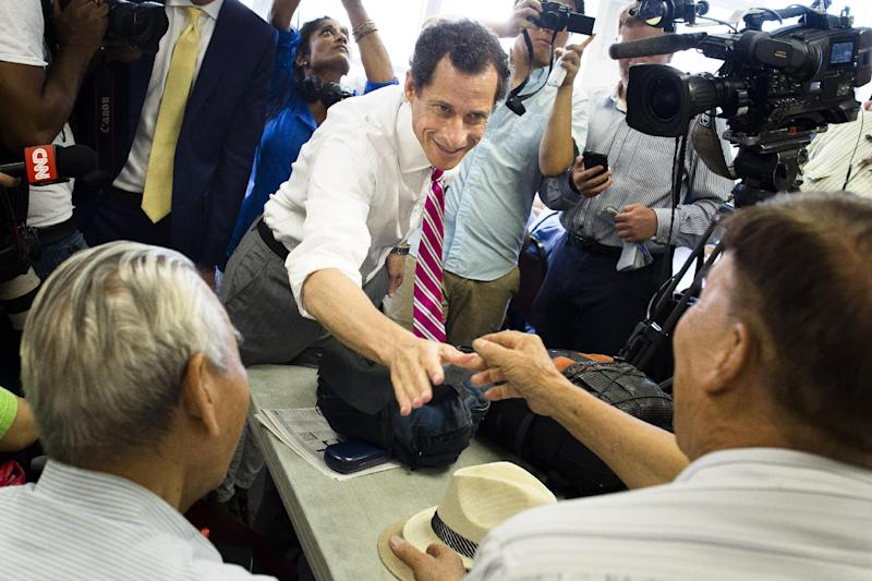 New York City mayoral candidate Anthony Weiner shakes hands with voters during a campaign stop at the Nan Shan Senior Center, Monday, July 29, 2013, in the Queens borough of New York. Weiner confirmed that campaign manager Danny Kedem resigned Saturday after reports surfaced that Weiner continued to exchange lewd photos and messages with women despite resigning from Congress in 2011 over the same behavior. (AP Photo/John Minchillo)