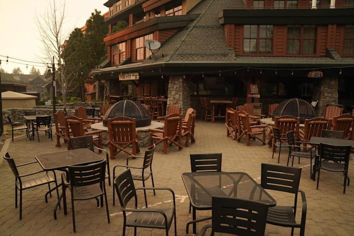 An empty restaurant is seen after a mandatory evacuation was ordered due to the Caldor fire in South Lake Tahoe.