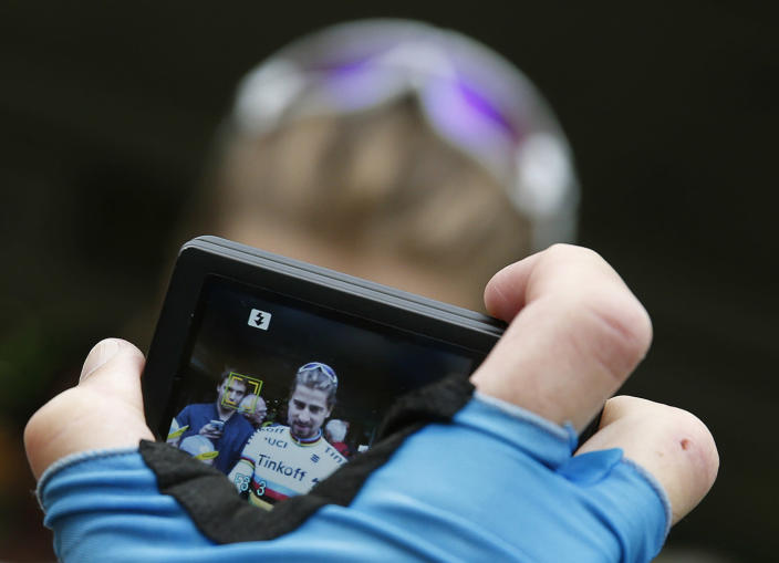 <p>A cycling fan takes a picture of Slovakia's Peter Sagan, prior to a training with his Tinkoff teammates prior to the start of the Tour de France cycling race near Coutances, France, July 1, 2016. (Photo: Christophe Ena/AP) </p>