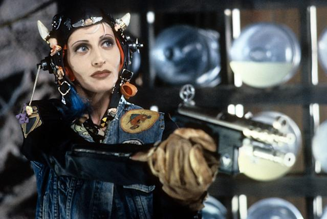 Lori Petty wearing bizarre head gear while holding a gun in a scene from the film 'Tank Girl', 1995. (Photo by United Artists/Getty Images)