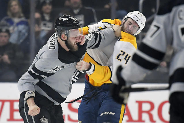 Los Angeles Kings left wing Kyle Clifford, left, fights with Nashville Predators defenseman Jarred Tinordi during the first period of an NHL hockey game Saturday, Jan. 4, 2020, in Los Angeles. (AP Photo/Mark J. Terrill)