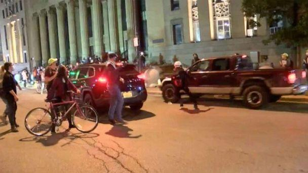 PHOTO: In this screen grab taken from a video, a car speeds past protesters in Buffalo, NY., Sept 23, 2020. (WKBW)