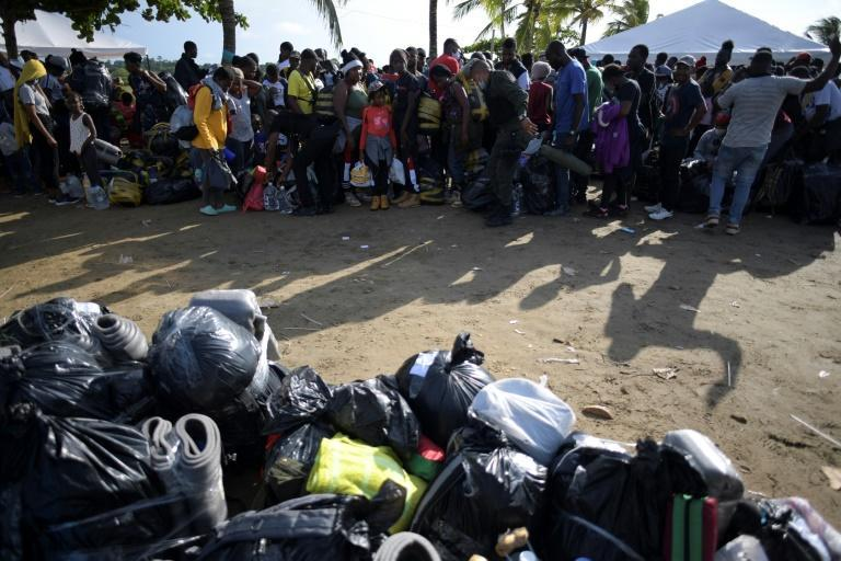 The migrants are waiting for limited places on a boat to Acandi, on the Panama border (AFP/Raul ARBOLEDA)