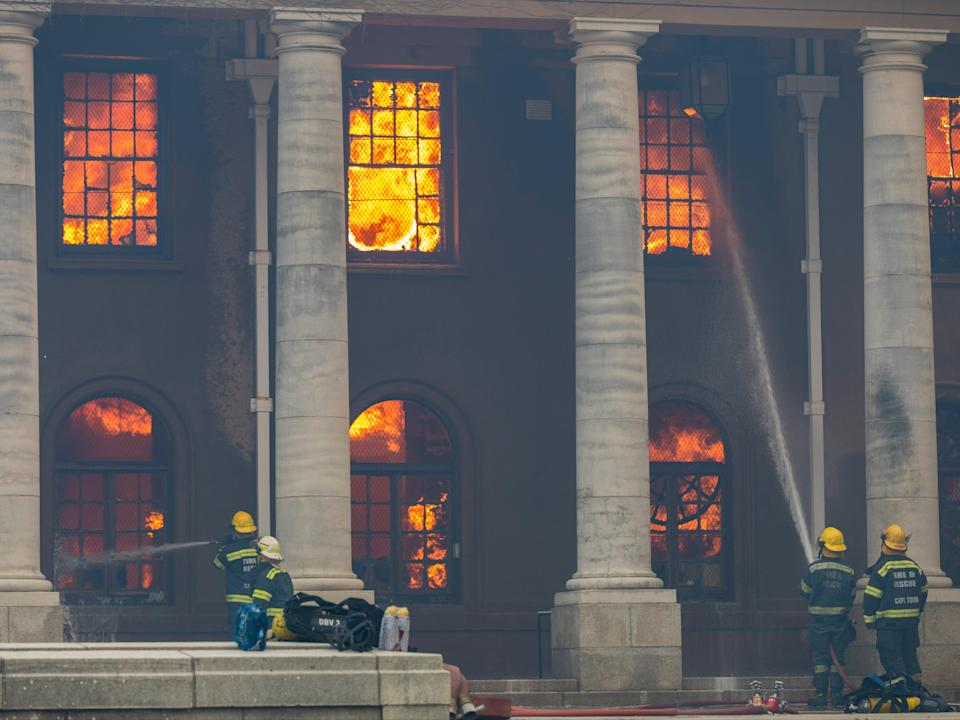 <p>Firefighters battle a blaze that destroyed the nearly 200-year-old Jagger Library on the University of Cape Town campus</p> (EPA)