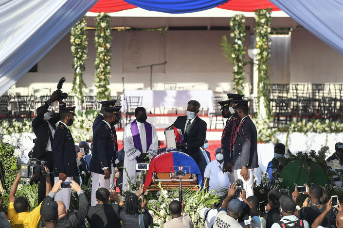 The funeral is held for slain Haitian President Jovenel Moise at his family home in Cap-Haitien, Haiti, early Friday, July 23, 2021. Moise was assassinated at his home in Port-au-Prince on July 7. (AP Photo/Matias Delacroix)
