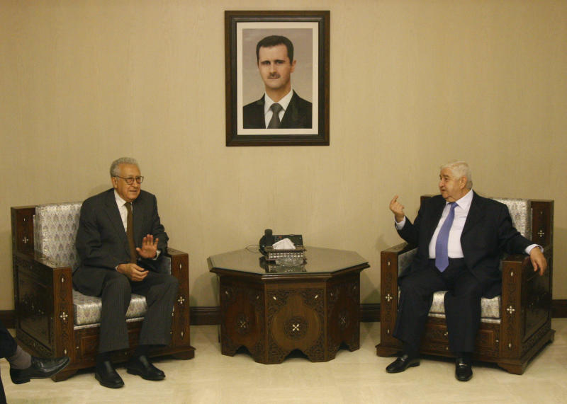 Lakhdar Brahimi, the U.N.-Arab League envoy to Syria, left, meets with Syrian Foreign Minister Walid Moallem, right, in Damascus, Syria Thursday Sept. 13, 2012. Brahimi replaced Kofi Annan, who left the job in frustration in August after his efforts failed to stem a conflict that started in March 2011. The new international envoy to Syria arrived in Damascus on Thursday for his first visit to the country since he took up the post in the midst of Syria's devastating civil war. (AP Photo/Muzaffar Salman)