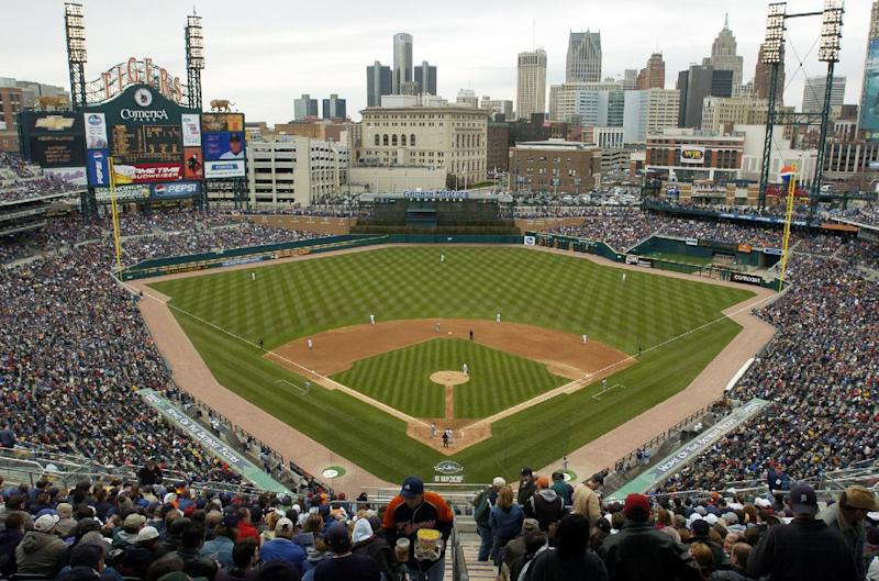 FILE - In this April 8, 2004, file photo, Baseball fans fill Comerica Park as the Detroit Tigers play the Minnesota Twins in an opening day baseball game in Detroit. The Lions, Tigers and Red Wings have had little trouble drawing fans despite the economic downturn in Detroit, so don't expect those franchises to crumble in light of the city's bankruptcy filing. But there are questions to answer, especially for the Red Wings, who are hoping to move from Joe Louis Arena into a new downtown facility that team and city officials announced plans for last month. (AP Photo/John F. Martin, File)