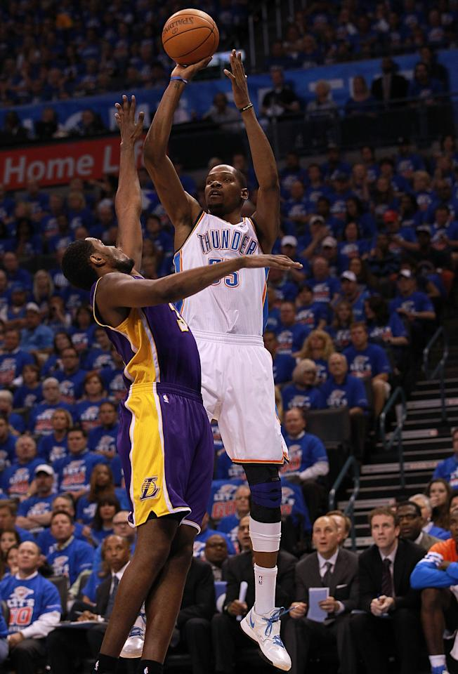 OKLAHOMA CITY, OK - MAY 21:  Kevin Durant #35 of the Oklahoma City Thunder takes a shot against Devin Ebanks #3 of the Los Angeles Lakers during Game Five of the Western Conference Semifinals of the 2012 NBA Playoffs at Chesapeake Energy Arena on May 21, 2012 in Oklahoma City, Oklahoma.  NOTE TO USER: User expressly acknowledges and agrees that, by downloading and or using this photograph, User is consenting to the terms and conditions of the Getty Images License Agreement.  (Photo by Ronald Martinez/Getty Images)