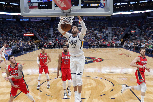Utah Jazz center Rudy Gobert (27) dunks during the first half of the team's NBA basketball game against the New Orleans Pelicans in New Orleans, Thursday, Jan. 16, 2020. (AP Photo/Gerald Herbert)