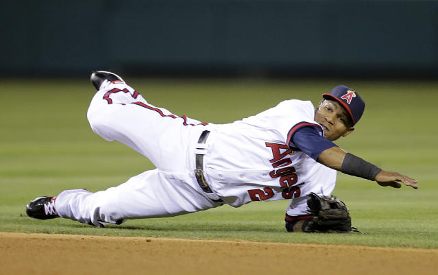 Los Angeles Angels' Erick Aybar watches his throw to first base after fielding a ball hit by Houston Astros' Jason Castro during the fourth inning of a baseball game on Friday, Aug. 16, 2013, in Anaheim, Calif. Castro was out at first. (AP Photo/Jae C. Hong)