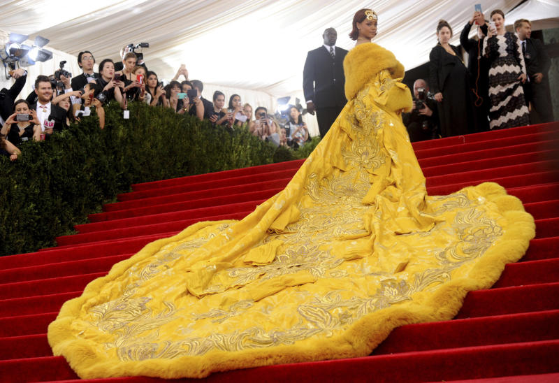 "FILE - This May 4, 2015 file photo shows singer Rihanna at The Metropolitan Museum of Art's Costume Institute benefit gala celebrating ""China: Through the Looking Glass"" in New York. (Photo by Charles Sykes/Invision/AP)"