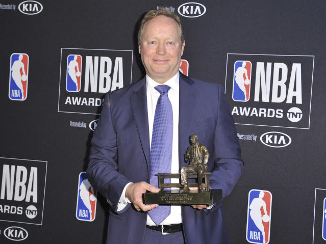 NBA coach Mike Budenholzer, of the Milwaukee Bucks, poses in the press room with the coach of the year award poses in the press room at the NBA Awards on Monday, June 24, 2019, at the Barker Hangar in Santa Monica, Calif. (Photo by Richard Shotwell/Invision/AP)