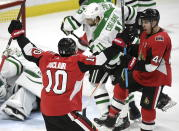 Ottawa Senators centre Jean-Gabriel Pageau (44) celebrates a goal against the Dallas Stars with left wing Anthony Duclair (10) during the first period of an NHL hockey game Sunday, Feb. 16, 2020, in Ottawa, Ontario. (Justin Tang/The Canadian Press via AP)