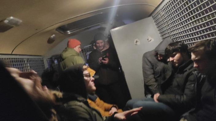 This photo released by Philipp Kyznetsov from his instagram account philipp_kuznetsov, shows a group of detained people inside the police bus in Moscow, Russia, Wednesday, Jan. 27, 2021. Russian protesters spent hours packed inside the vehicles and lodged in corridors of police precincts as authorities struggle to allocate thousands of people arrested during the rallies sparked by arrest of the opposition leader Alexey Navalny. (Philipp Kyznetsov via AP)