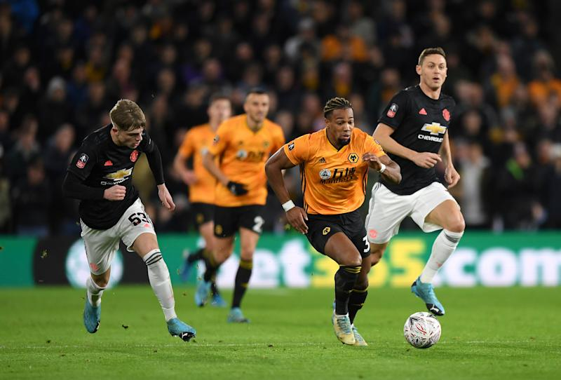 Adama Traore of Wolverhampton Wanderers breaks away from Brandon Williams. (Credit: Getty Images)