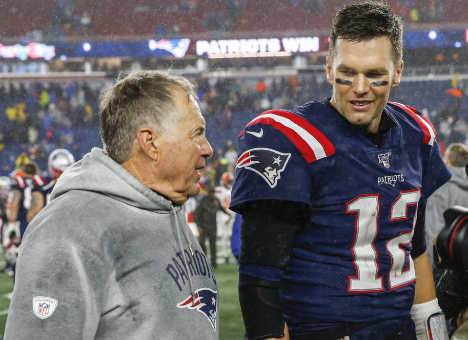 Oct 27, 2019; Foxborough, MA, USA; New England Patriots head coach Bill Belichick with quarterback Tom Brady (12) after defeating the Cleveland Browns at Gillette Stadium. Mandatory Credit: Greg M. Cooper-USA TODAY Sports