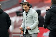 Back in it: Scott Parker celebrates Fulham's win at Liverpool which leaves four sides separated by four points at the bottom of the table