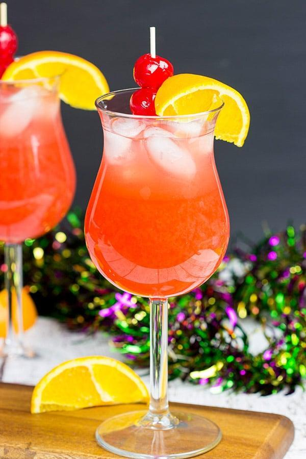 """<p>Tropical, fruity, and full of rum, this passion-fruit drink was made famous by Bourbon Street bar Pat O'Brien's. With all the best flavors of the city, hurricanes will pretty much sweep you off your feet.</p> <p><strong>Get the recipe</strong>: <a href=""""https://spicedblog.com/classic-new-orleans-hurricane.html"""" class=""""link rapid-noclick-resp"""" rel=""""nofollow noopener"""" target=""""_blank"""" data-ylk=""""slk:classic New Orleans hurricane"""">classic New Orleans hurricane</a></p>"""