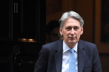FILE PHOTO - Britain's Finance Secretary Philip Hammond leaves 11 Downing Street, London