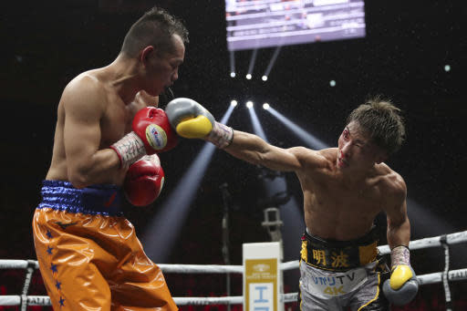 Japan's Naoya Inoue, right, sends a right to Philippines' Nonito Donaire in the eighth round of their World Boxing Super Series bantamweight final match in Saitama, Japan, Thursday, Nov. 7, 2019. Inoue beat Donaire with a unanimous decision to win the championship. (AP Photo/Toru Takahashi)