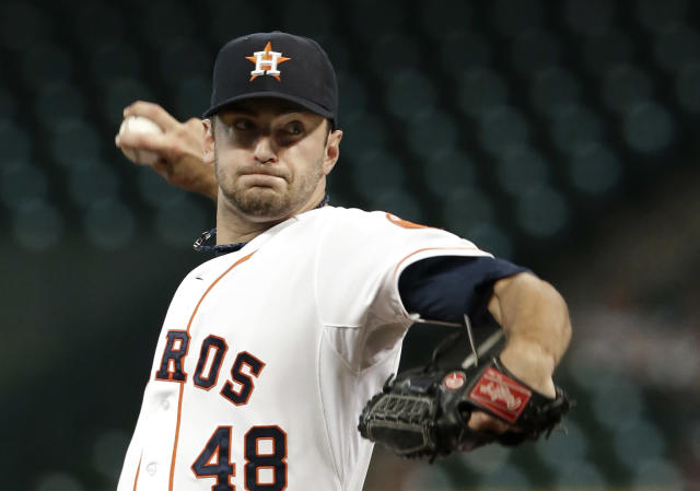 Houston Astros' Jarred Cosart delivers a pitch against the Seattle Mariners in the first inning of a baseball game Tuesday, July 1, 2014, in Houston. (AP Photo/Pat Sullivan)