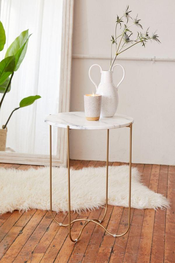 """<p>This <a href=""""https://www.popsugar.com/buy/Annette%20Side%20Table-472009?p_name=Annette%20Side%20Table&retailer=urbanoutfitters.com&price=79&evar1=casa%3Aus&evar9=46417524&evar98=https%3A%2F%2Fwww.popsugar.com%2Fhome%2Fphoto-gallery%2F46417524%2Fimage%2F46417904%2FAnnette-Side-Table&list1=shopping%2Cfurniture%2Cbedrooms%2Chome%20shopping&prop13=mobile&pdata=1"""" rel=""""nofollow"""" data-shoppable-link=""""1"""" target=""""_blank"""" class=""""ga-track"""" data-ga-category=""""Related"""" data-ga-label=""""https://www.urbanoutfitters.com/shop/annette-side-table?category=furniture&amp;color=010&amp;type=REGULAR"""" data-ga-action=""""In-Line Links"""">Annette Side Table</a> ($79) looks triple the price.</p>"""