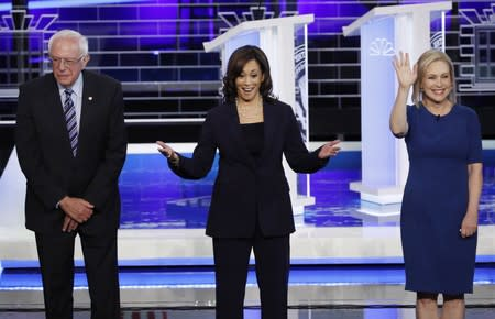 Candidates pose before the start of the second night of the first U.S. 2020 presidential election Democratic candidates debate in Miami, Florida, U.S.