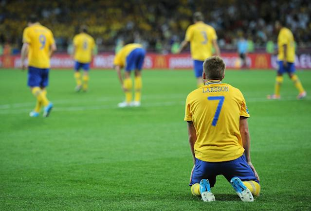 KIEV, UKRAINE - JUNE 15: Sebastian Larsson of Sweden sits dejected during the UEFA EURO 2012 group D match between Sweden and England at The Olympic Stadium on June 15, 2012 in Kiev, Ukraine. (Photo by Christopher Lee/Getty Images)