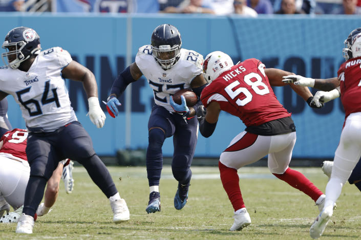 Tennessee Titans running back Derrick Henry (22) carries the ball against Arizona Cardinals middle linebacker Jordan Hicks (58) in the second half of an NFL football game Sunday, Sept. 12, 2021, in Nashville, Tenn. (AP Photo/Wade Payne)