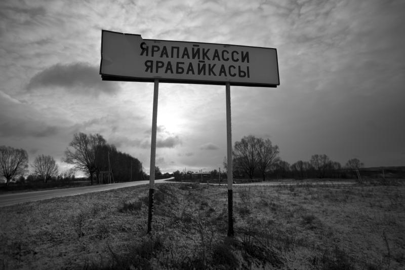 In this Nov. 14, 2012, photo, a broken sign reads Yarabaikasy at the outskirts of the village of Yarabaikasy, near Cheboksary, the capital city of Chuvashia, Russia. Eduard Mochalov has found a new lease on life as a crusading journalist investigating corruption in his native region, fueled by tips from disgruntled businessmen and government workers. Undeterred by a system where the law is selectively used to protect the powerful and crack down on critics, Mochalov has quickly earned cult status _ not to mention the ire of countless local officials _ throughout the small province of Chuvashia. (AP Photo/Alexander Zemlianichenko)