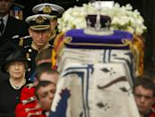 <p>The Queen and Prince Charles walk behind the Queen Mother's coffin following her funeral at Westminster Abbey in central London. (PA Archive) </p>