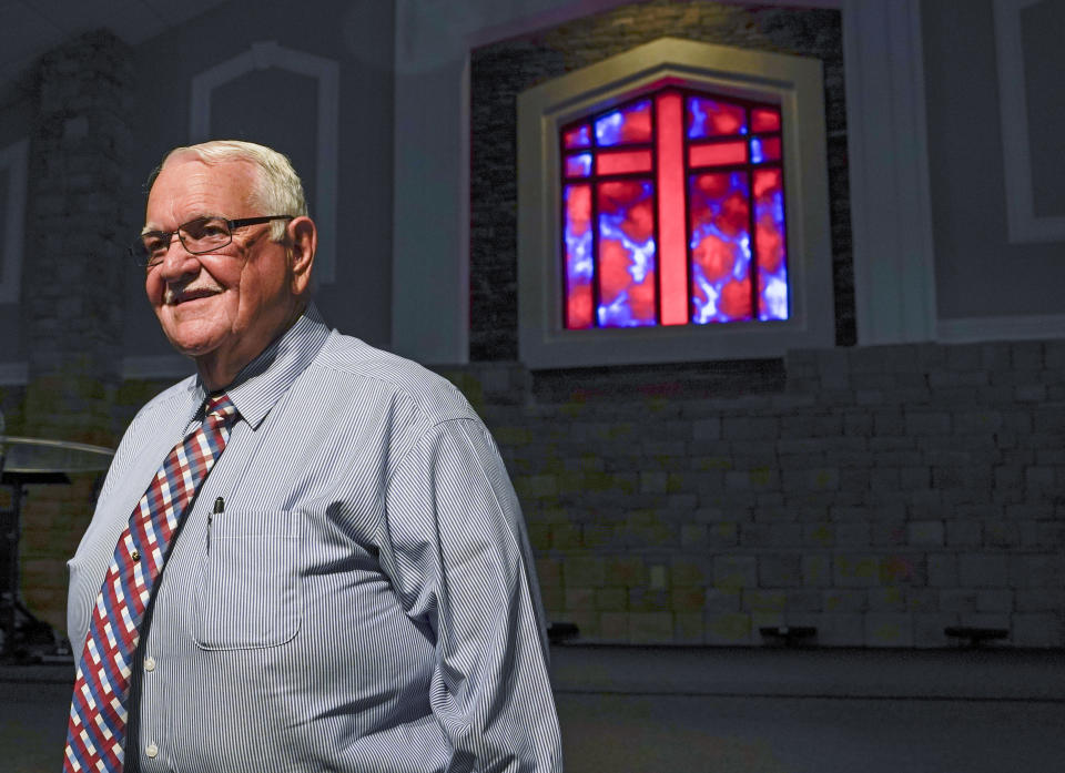 Pastor Dwight Allen of The Anchor Church of God, stands inside the church sanctuary Tuesday, Aug. 10, 2021, in Callahan, Fla. Allen has been vaccinated and encourages his parishioners to do so as well. (AP Photo/John Raoux)