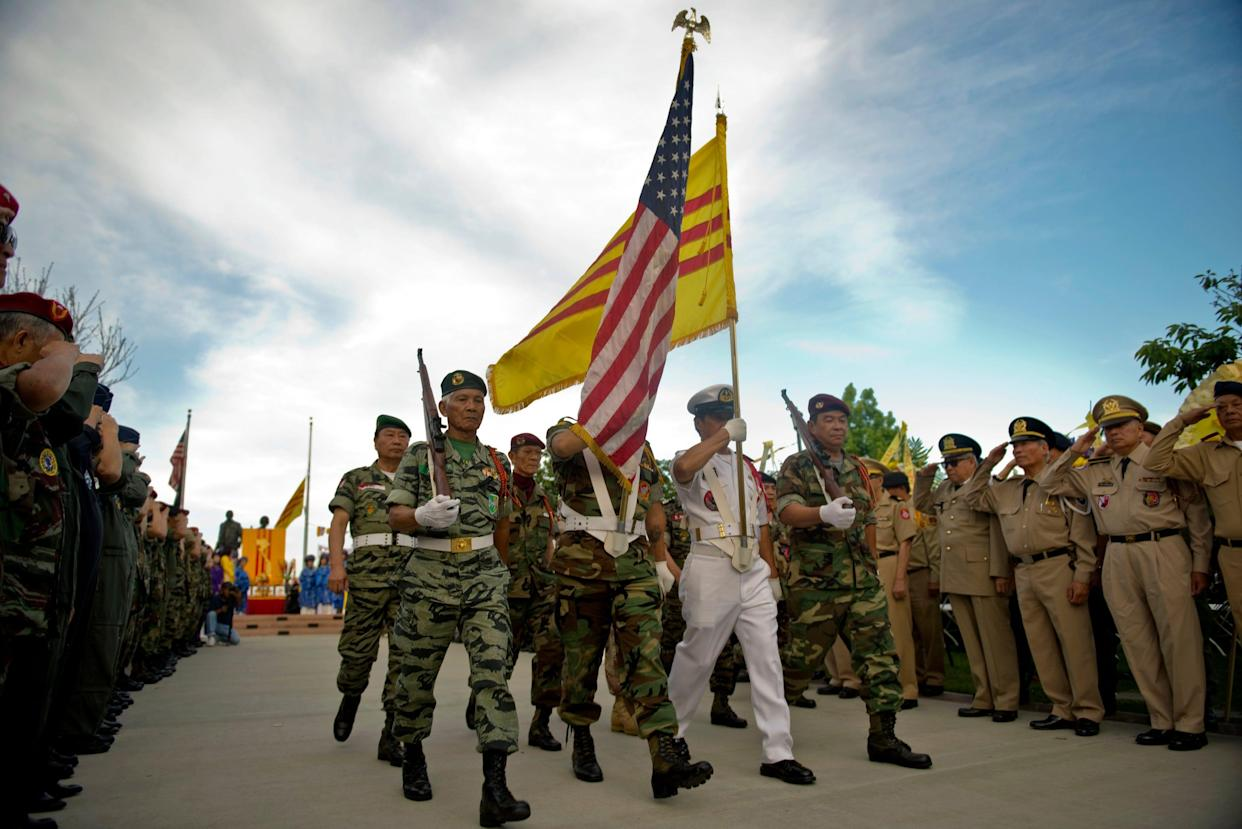 The South Vietnamese and American flags fly at a commemoration of the fall of Saigon in Westminster, California, on April 30, 2015.