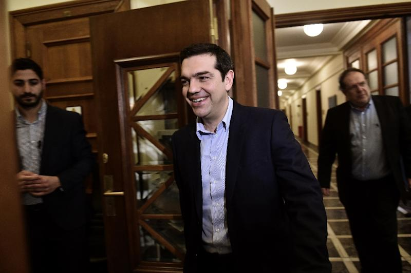 Greek Prime Minister Alexis Tsipras arrives for a ministerial meeting at the parliament in Athens on February 24, 2015 (AFP Photo/Aris Messinis)