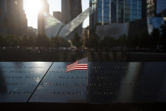 <p>An American flag is left at the North pool memorial site before a commemoration ceremony for the victims of the September 11 terrorist attacks at the National September 11 Memorial, September 11, 2017 in New York City. In New York City and throughout the United States, the country is marking the 16th anniversary of the September 11 terrorist attacks. (Photo: Drew Angerer/Getty Images) </p>