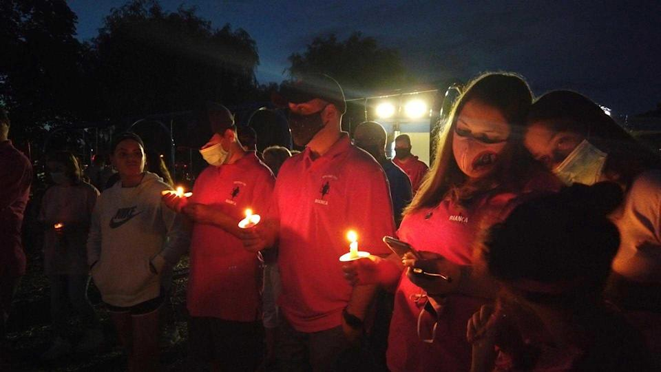 Family members and friends attend a candlelight vigil in memory of Bianca.
