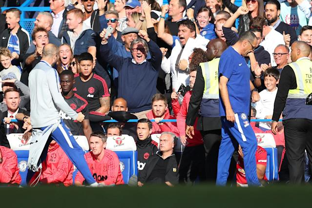 Chelsea assistant Marco Ianni celebrates Ross Barkley's equalizer in front of Jose Mourinho and the Manchester United bench. (Getty)