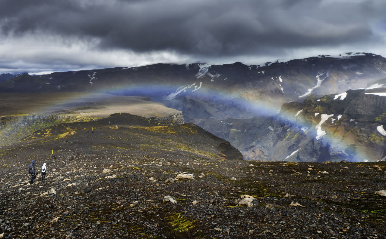 A landscape view of a rainbow appearing near a waterfall. (Michael Fersch/Caters News Agency)