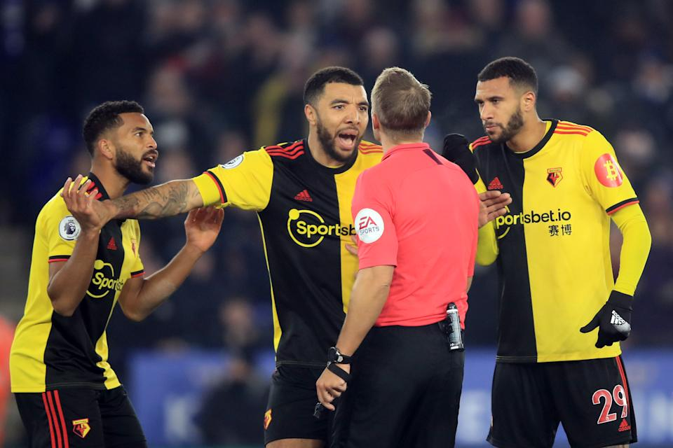 LEICESTER, ENGLAND - DECEMBER 04: Watford player led by Troy Deeney argue with  referee Craig Pawson over the penalty decision during the Premier League match between Leicester City and Watford FC at The King Power Stadium on December 4, 2019 in Leicester, United Kingdom. (Photo by Marc Atkins/Getty Images)