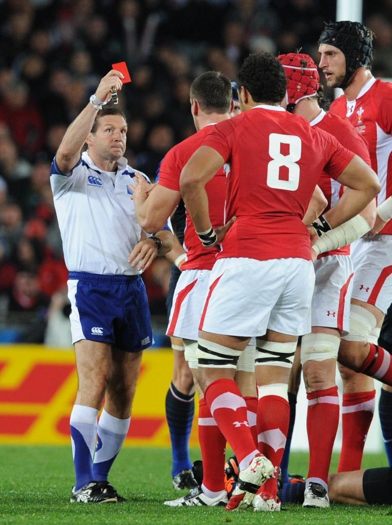 Referee Alain Rolland gives a red card to Wales' flanker Sam Warburton during the 2011 Rugby World Cup semi-fianl against France at the Eden Park in Auckland on October 15, 2011 (AFP Photo/Gabriel Bouys)
