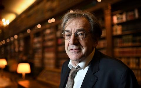 Alain Finkielkraut poses in the French Academy's library - Credit: ERIC FEFERBERG/AFP