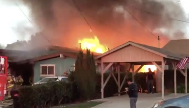 Two dead as small plane crashes into San Diego house