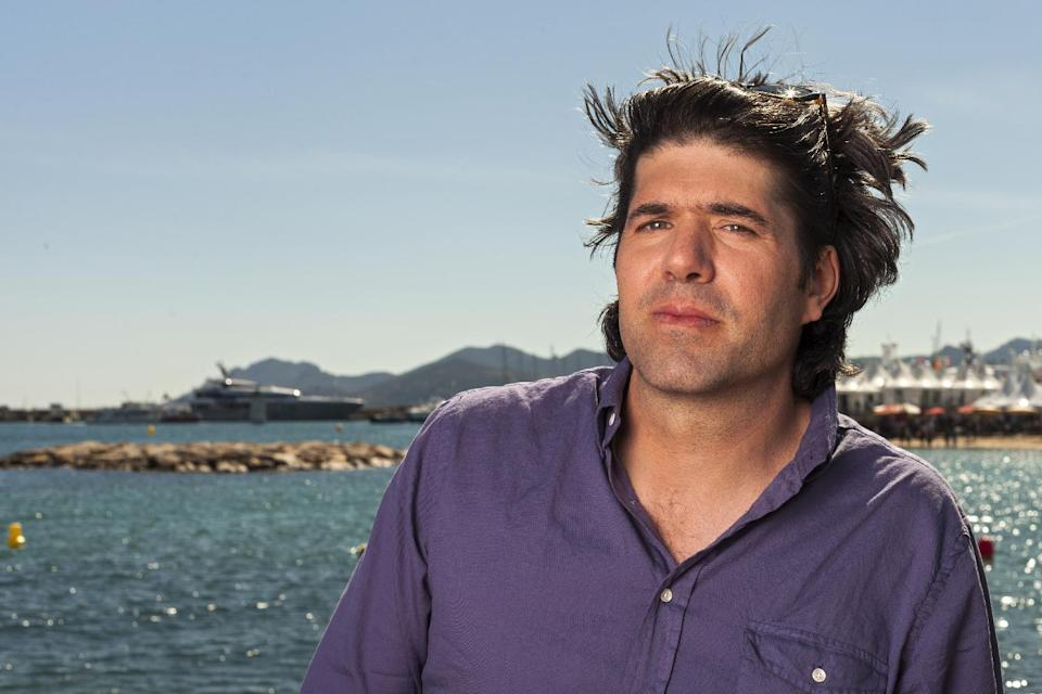 Director JC Chandor poses for portraits at the 66th international film festival, in Cannes, southern France, Thursday, May 23, 2013. (AP Photo/Laurent Emmanuel)