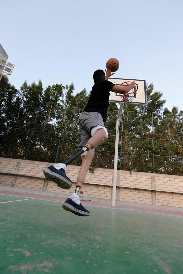 Hussain Al Howicom, a Saudi born with congenital amputation, plays basketball in Dammam, Saudi Arabia, April 10, 2018. Picture taken April 10, 2018. REUTERS/Hamad I Mohammed