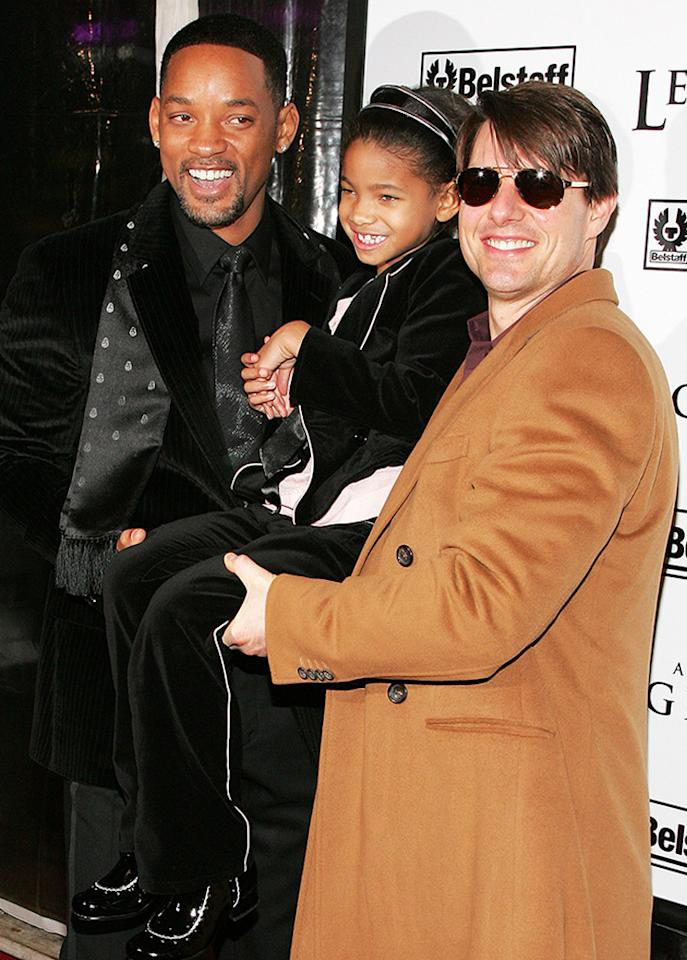 The little lady was right at home while being lifted up by two of the biggest movie stars in the world at the 'I Am Legend' premiere in 2007. (Getty Images)